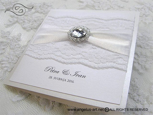 wedding invitation with lace and brooch