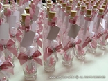luxury wedding invitation in botle with pink bow