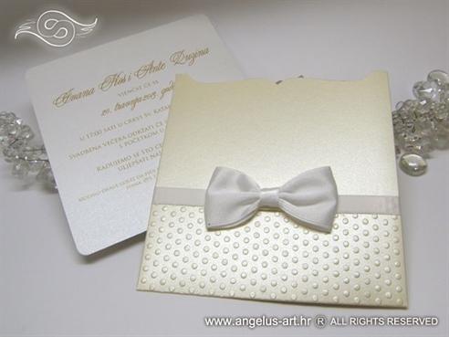 cream wedding invitation with white bow