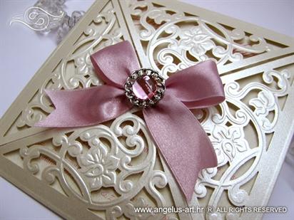laser cut wedding invitation with brooch
