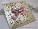 laser cut wedding invitation with decorative brooch