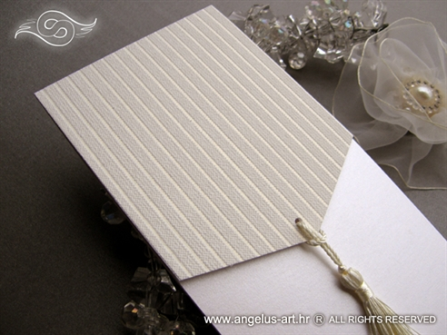 white elegant wedding invitation with fringe